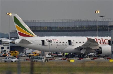 Emergency services attend to a Boeing 787 Dreamliner, operated by Ethiopian Airlines, after it caught fire at Britain's Heathrow airport in west London July 12, 2013. REUTERS/Toby Melville