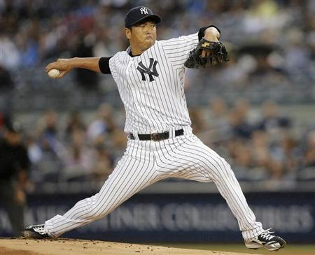 New York Yankees starting pitcher Hiroki Kuroda throws a pitch to the Minnesota Twins in the first inning of their MLB American League baseball game at Yankee Stadium in New York July 12, 2013. REUTERS/Ray Stubblebine