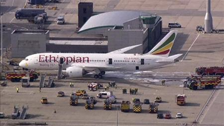 Emergency crew surrounds a Boeing 787 Dreamliner, operated by Ethiopian Airlines, which caught fire at Britain's Heathrow airport in this July 12, 2013 still image taken from video. REUTERS/Pool via Reuters TV