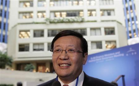 Chinese Minister of Finance Lou Jiwei smiles before the G20 finance ministers and central bank governors family photo during 2013 Spring Meeting of the International Monetary Fund and World Bank in Washington, April 19, 2013. REUTERS/Yuri Gripas