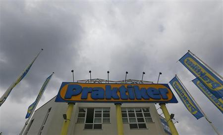 Clouds are pictured above the entrance of German do-it-yourself retailer Praktiker in Kolbermoor near Rosenheim July 11, 2013. REUTERS/Michael Dalder