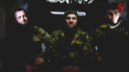 An undated still image taken from video shows the address of Chechen rebels, led by Emir of the Caucasus Doku Umarov (C). Chechen rebel leader Umarov has said his forces will carry out more attacks and that Russia faces a year of ''blood and tears'' if it refuses to abandon its North Caucasus territories, according to a story on February 5, 2011. REUTERS/www.kavkazcenter.com/Reuters TV