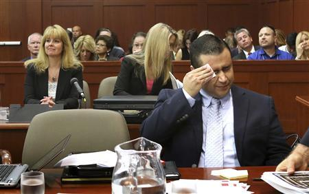 George Zimmerman wipes perspiration from his face after arriving in the courtroom for his trial in Seminole circuit court in Sanford, Florida July 12, 2013. REUTERS/Joe Burbank/Pool
