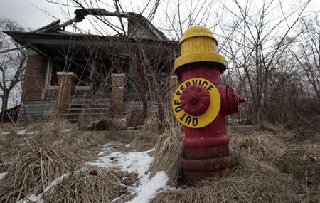 A fire hydrant is seen with an ''Out of Service'' sign on a blighted street on the east side of Detroit, Michigan in this March 22, 2013 file photo. REUTERS/ Rebecca Cook/Files