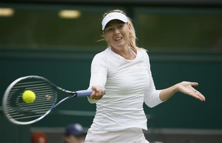 Maria Sharapova of Russia hits a return to Kristina Mladenovic of France in their women's singles tennis match at the Wimbledon Tennis Championships, in London June 24, 2013. REUTERS/Stefan Wermuth