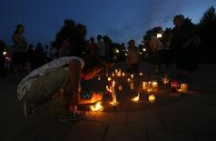 People in Gatineau, Quebec, collect candles at the conclusion of a vigil for the victims of the fatal train disaster in Lac-Megantic, July 12, 2013. REUTERS/Chris Wattie