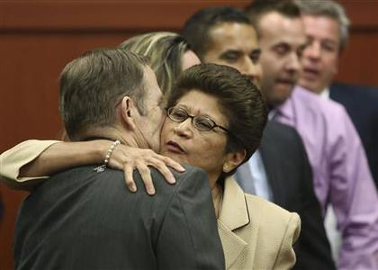 George Zimmerman's parents Robert Zimmerman Sr. and Gladys Zimmerman celebrate following their son's his not guilty verdict in the 2012 shooting death of Trayvon Martin at the Seminole County Criminal Justice Center in Sanford, Florida, July 13, 2013. REUTERS-Gary W. Green-Pool