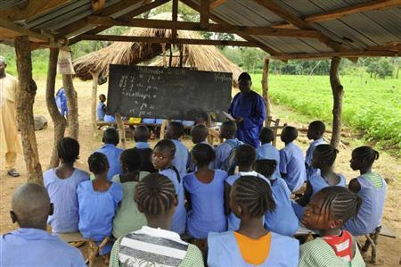 A teacher conducts a lesson under a makeshift classroom at a relief centre for flood victims at St. Boniface primary school in Idah in Nigeria's central state of Kogi October 3, 2012. REUTERS/Afolabi Sotunde