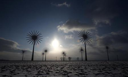 Wind turbines are pictured in this multiple exposure at the German village of Feldheim February 21, 2013. REUTERS/Tobias Schwarz