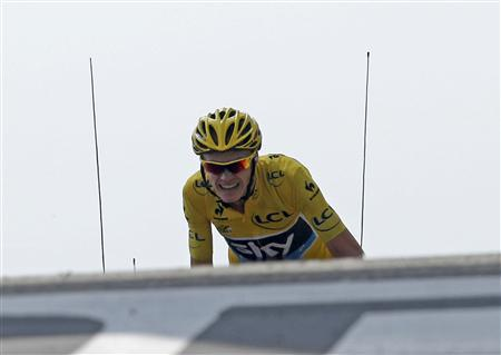 Race leader's yellow jersey Team Sky rider Christopher Froome of Britain cycles to win the 242.5 km fifteenth stage of the centenary Tour de France cycling race from Givors to Mont Ventoux July 14, 2013. REUTERS/Jean-Paul Pelissier