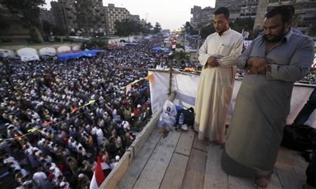 Members of the Muslim Brotherhood and supporters of deposed Egyptian President Mohamed Mursi perform evening prayers at the Rabaa Adawiya square, where they are camping, in Cairo July 12, 2013. REUTERS/Amr Abdallah Dalsh