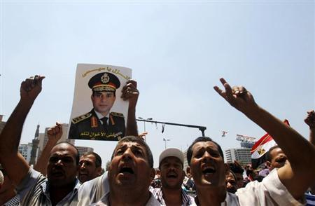 Protesters, who are against former President Mohamed Mursi, shout slogans during a rally at Tahrir square in Cairo July 5, 2013. REUTERS/Khaled Abdullah
