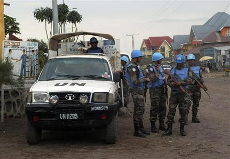 U.N. peacekeepers patrol the streets during the visit of U.N. Secretary-General Ban Ki-moon and World Bank President Jim Yong Kim to Goma, in the Democratic Republic of Congo's war-torn east, May 23, 2013. REUTERS/Jonny Hogg