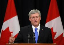 Canadian Prime Minister Stephen Harper answers questions on the train explosion in Quebec in Calgary, Alberta, July 6, 2013. REUTERS/Todd Korol