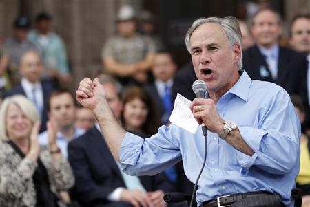 Texas Attorney General Greg Abbott speaks during an anti-abortion rally at the State Capitol in Austin, Texas, July 8, 2013. REUTERS/Mike Stone (UNITED STATES) - RTX11HAF