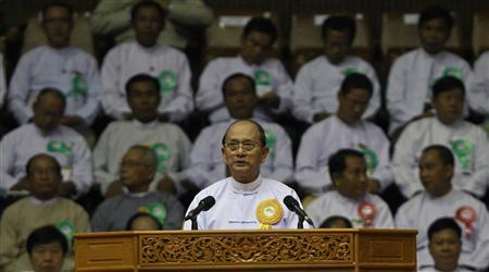 Myanmar's President Thein Sein gives a speech during a launch ceremony for a rural development and social economy improvement program, at a stadium in Yangon June 2, 2013. REUTERS/Soe Zeya Tun