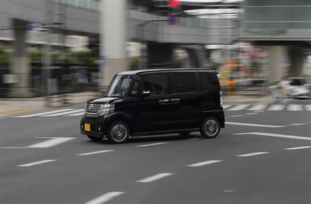 Honda Motor Co's N Box minicar goes on a street in Tokyo July 13, 2013 Picture taken July 13, 2013. REUTERS/Toru Hana