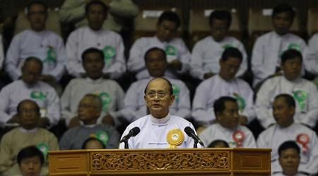 Myanmar's President Thein Sein gives a speech during a launch ceremony for a rural development and social economy improvement program, at a stadium in Yangon June 2, 2013.REUTERS/Soe Zeya Tun