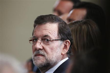 Spain's Prime Minister Mariano Rajoy attends a presentation on social action entities at the Moncloa Palace in Madrid July 11, 2013. REUTERS/Juan Medina