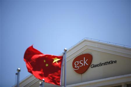 A Chinese national flag flutters in front of a GlaxoSmithKline (GSK) office building in Shanghai in this July 12, 2013 file photo. REUTERS/Aly Song/Files