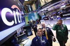 Traders work at the trading post that trades Citigroup stock on the floor of the New York Stock Exchange, in this October 16, 2012 file photo. REUTERS/Brendan McDermid/Files