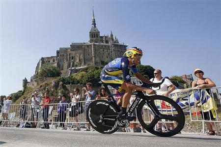 Team Saxo-Tinkoff rider Alberto Contador of Spain cycles past the Mont Saint-Michel during the 32 km individual time trial eleventh stage of the centenary Tour de France cycling race from Avranches to Mont-Saint-Michel July 10, 2013. REUTERS/Eric Gaillard