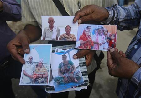 Relatives of missing people, affected by the flash floods and landslides, display their photographs outside the Indian Air Force base in Dehradun, in the Himalayan state of Uttarakhand June 26, 2013. REUTERS/Danish Siddiqui