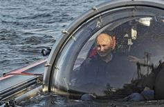 "Russia's President Vladimir Putin is seen through the glass of C-Explorer 5 submersible after a dive to see the remains of the naval frigate ""Oleg"", which sank in the 19th century, in the Gulf of Finland in the Baltic Sea July 15, 2013. REUTERS/Aleksey Nikolskyi/RIA Novosti/Kremlin"