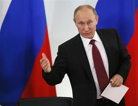 Russian President Vladimir Putin gestures during his visit to the State Military-Historical Museum of Prokhorovka Field July 12, 2013. REUTERS/Yuri Kochetkov/Pool