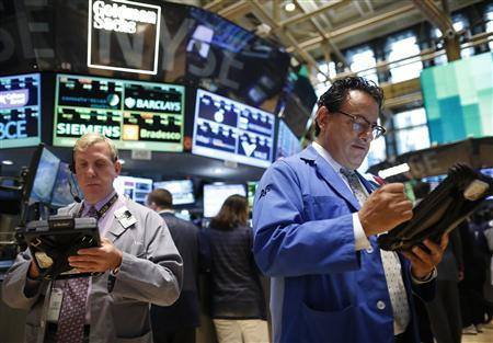 Traders work on the floor at the New York Stock Exchange July 10, 2013. REUTERS/Brendan McDermid