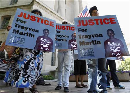 Members of the National Black Church Initiative protest as they ask for justice for Trayvon Martin, outside the Department of Justice in Washington July 15, 2013. REUTERS/Jose Luis Magana