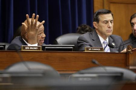Ranking member Rep. Elijah Cummings (D-MD) (L), seated with committee chairman U.S. Representative Darrell Issa (R-CA) (R), questions the panel during a House Oversight and Government Reform Committee hearing on targeting of political groups seeking tax-exempt status from by the IRS, on Capitol Hill in Washington, May 22, 2013. REUTERS/Jonathan Ernst