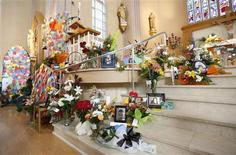 A memorial is pictured inside Sainte-Agnes church in Lac Megantic, July 15, 2013. REUTERS/Mathieu Belanger
