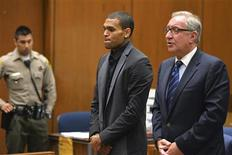 Singer Chris Brown and attorney Mark Geragos (R) attend a probation progress hearing in Los Angeles Superior Court July 15, 2013. REUTERS/Alberto E. Rodriguez/Pool