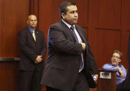George Zimmerman enters the courtroom for his trial in Sanford, Florida July 13, 2013 during the trial of George Zimmerman in the shooting death of Trayvon Martin. REUTERS/Gary W. Green/Pool