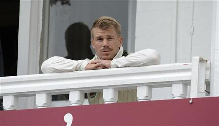 Australia's David Warner looks on from the dressing room balcony before the first Ashes cricket test match against England at Trent Bridge cricket ground in Nottingham, England July 10, 2013. REUTERS/Philip Brown
