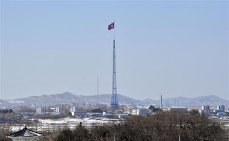 A North Korean flag flutters in the propaganda village of Gijeongdong as seen from South Korea's Taesungdong freedom village, near the border village of Panmunjom, during a graduation ceremony for Taesungdong Elementary School, in Paju February 15, 2013. REUTERS/Jung Yeon-je/Pool