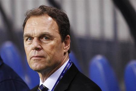 Australia's national fotball team head coach Holger Osieck looks at his players before their 2014 World Cup qualifying match against Japan in Saitama, north of Tokyo, June 4, 2013. REUTERS/Yuya Shino