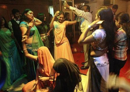 Bar girls perform at a dance bar in Bombay May 5, 2005. Picture taken on May 5, 2005. REUTERS/Punit Paranjpe/Files
