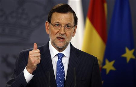 Spain's Prime Minister Mariano Rajoy gestures during a joint news conference with his Polish counterpart Donald Tusk (not pictured) at Moncloa Palace in Madrid July 15, 2013. REUTERS/Sergio Perez