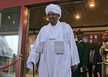 Sudanese President Omar al-Bashir walks out of a hotel in Abuja July 14, 2013. REUTERS/Afolabi Sotunde