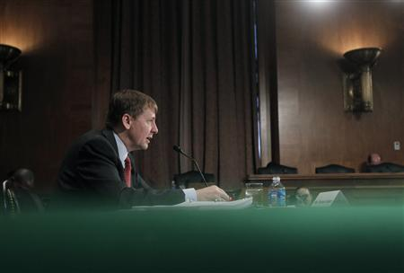 Consumer Financial Protection Bureau Director Richard Cordray delivers his organization's semi-annual report to Congress at a Senate Banking, Housing and Urban Affairs Committee hearing on Capitol Hill in Washington, April 23, 2013. REUTERS/Jason Reed