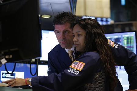 Traders work on the floor at the New York Stock Exchange, July 16, 2013. REUTERS/Brendan McDermid