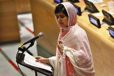 Malala Yousafzai, wearing a white shawl that had belonged to former Pakistani Prime Minister Benazir Bhutto, gives her first speech since the Taliban in Pakistan tried to kill her for advocating education for girls, at the United Nations Headquarters in New York, July 12, 2013. REUTERS/Brendan McDermid