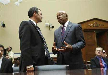 Acting IRS Commissioner Danny Werfel (L) speaks with Rep. Elijah Cummings (D-MD) before a House Oversight and Government reform hearing on 'Collected and Wasted - The IRS Spending Culture and Conference Abuses, on Capitol Hill in Washington, June 6, 2013. REUTERS/Jason Reed