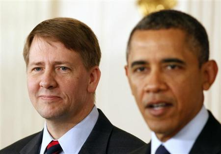 President Barack Obama (R) speaks next to Richard Cordray after Obama announced Cordray's renomination to lead the Consumer Financial Protection Bureau in the State Dining Room of the White House in Washington, January 24, 2013. REUTERS/Larry Downing