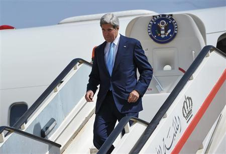 U.S. Secretary of State John Kerry steps off his plane upon his arrival at Queen Alia International Airport in Amman, July 16, 2013. REUTERS/Mandel Ngan/Pool