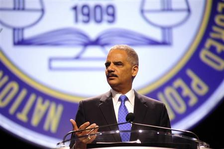U.S. Attorney General Eric Holder speaks at the annual convention of the National Association for the Advancement of Colored People (NAACP) in Orlando July 16, 2013. REUTERS/David Manning