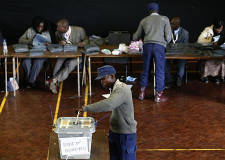 A Zimbabwean policeman casts his vote in the capital Harare July 15, 2013. REUTERS/Philimon Bulawayo
