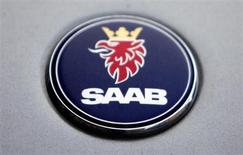 The logo of Swedish manufacturer Saab is seen on a car in Prague June 13, 2012. REUTERS/David W Cerny